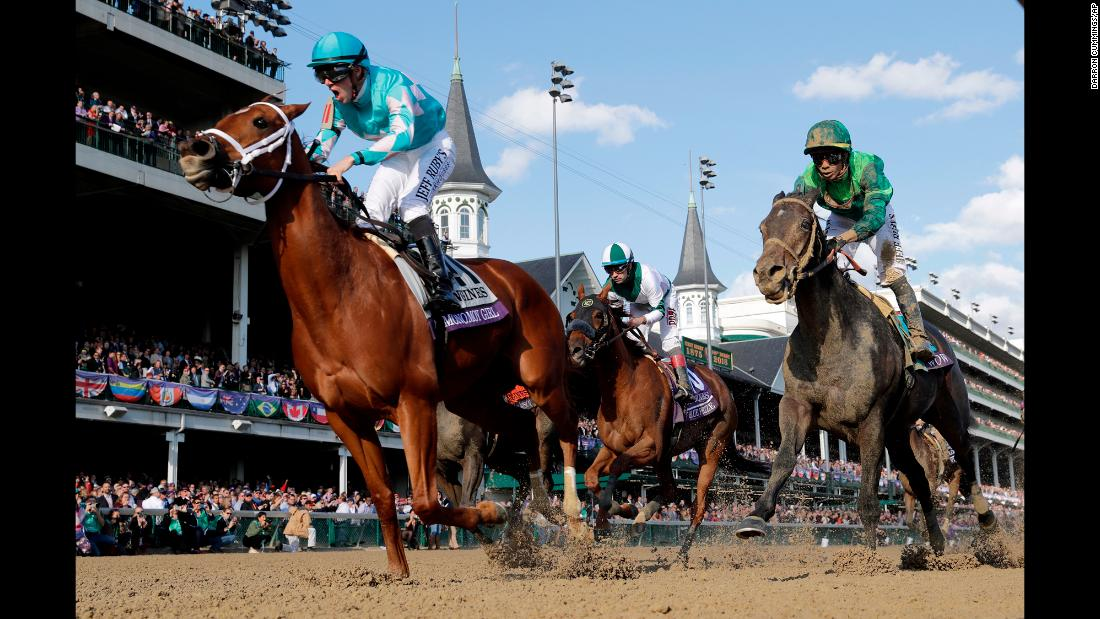Florent Geroux, left, celebrates as he rides Monomoy Girl to victory in the Breeders' Cup Distaff horse race at Churchill Downs, Saturday, November 3, 2018, in Louisville, Kentucky.