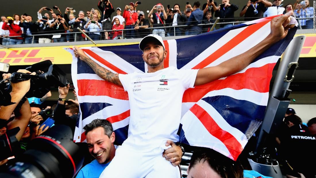 "Lewis Hamilton of Great Britain celebrates with his team after winning the Formula One Grand Prix of Mexico on October 28 in Mexico City. Hamilton became just the third driver in history to win five or <a href=""https://www.cnn.com/2018/10/29/motorsport/lewis-hamilton-fifth-world-title-formula-one-great-spt-intl/index.html"" target=""_blank"">more career Formula One world titles</a>."
