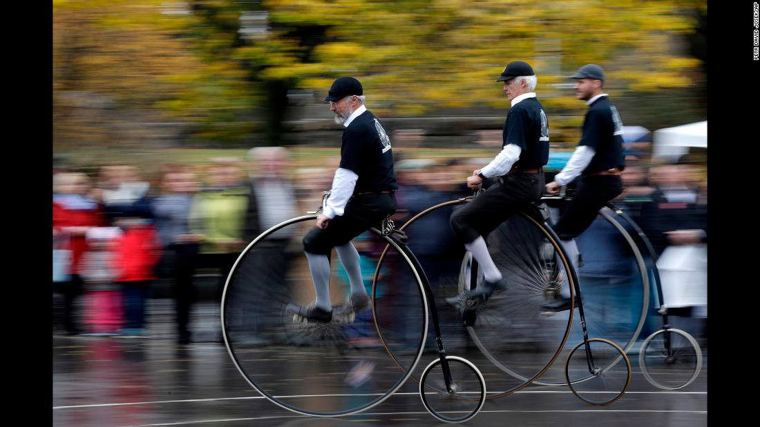 Enthusiasts dressed in historical costumes enjoy a ride on penny-farthing bicycles during their traditional race in Prague, Czech Republic on November 3, 2018.