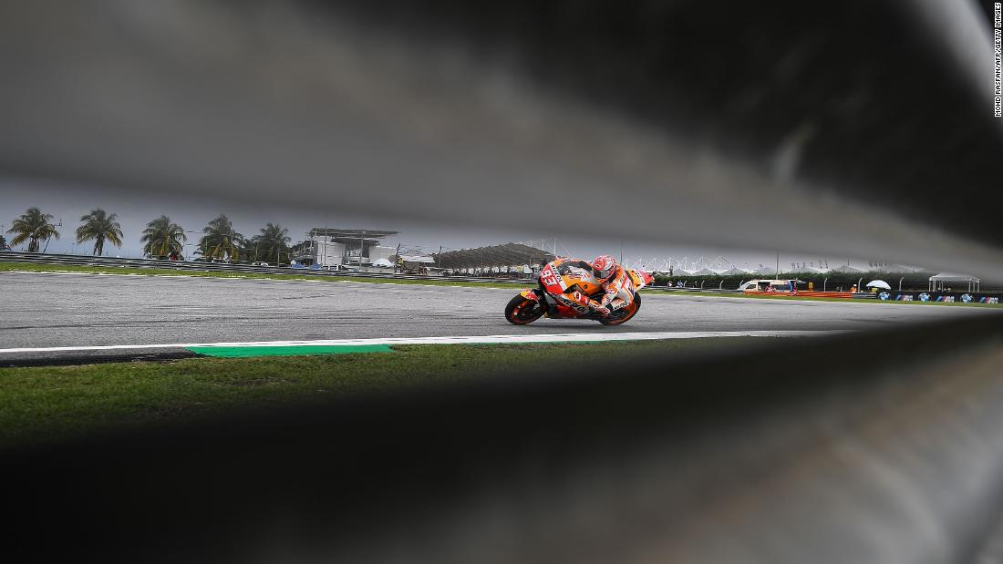 Repsol Honda Team's Spanish rider Marc Marquez negotiates a corner during the second practice session of the Malaysia MotoGP at the Sepang International Circuit in Sepang on November 2, 2018.