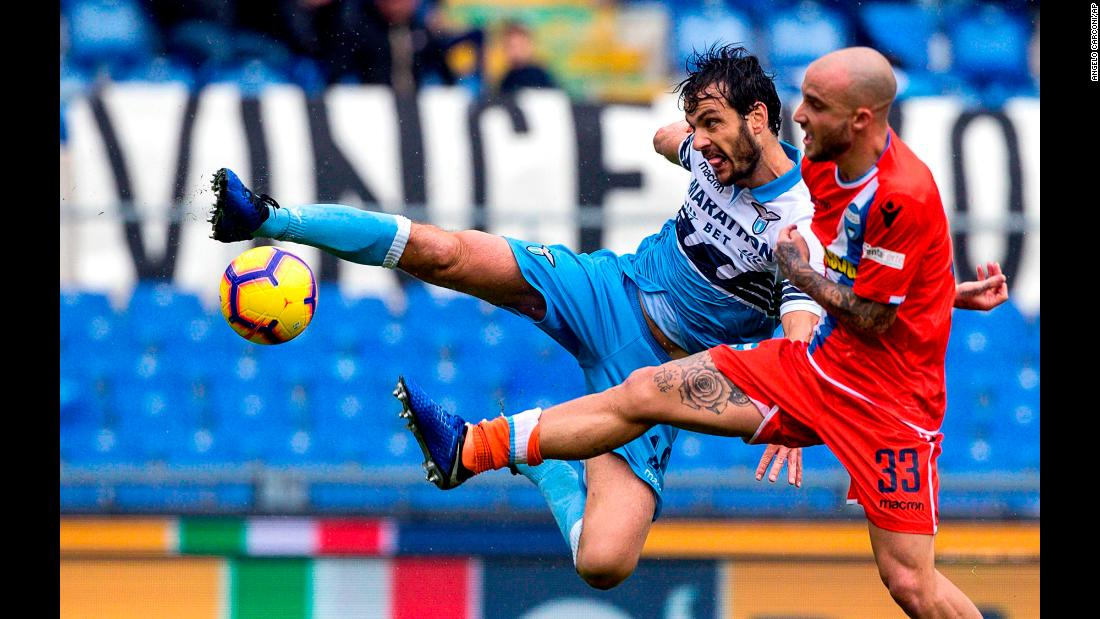 Lazio's Marco Parolo and SPAL's Filippo Costa vie for the ball during the Serie A soccer match between SS Lazio and SPAL at the Olympic stadium in Rome on November 4, 2018.