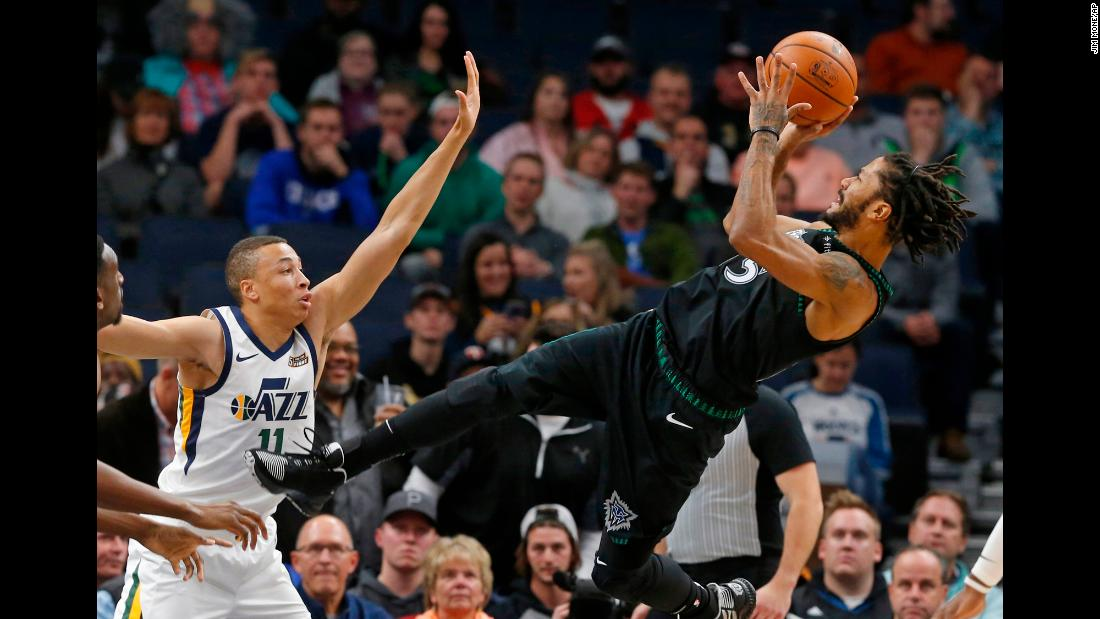 Minnesota Timberwolves' Derrick Rose takes a shot against Utah Jazz's Dante Exum in a game on October 31 in Minneapols, Minn. The oft-injured star scored a career-high 50 points in the game.