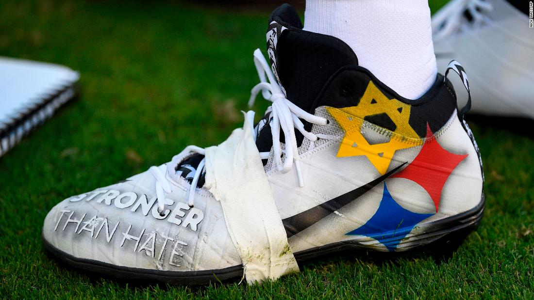 "Pittsburgh Steelers quarterback Ben Roethlisberger wears cleats emblazoned with a message recognizing last month's mass shooting at the Tree of Life Synagogue in Pittsburgh. The cleats feature the words ""Stronger Than Hate"" and a modified version of the Steelers logo, substituting the usual gold star with the Jewish Star of David."