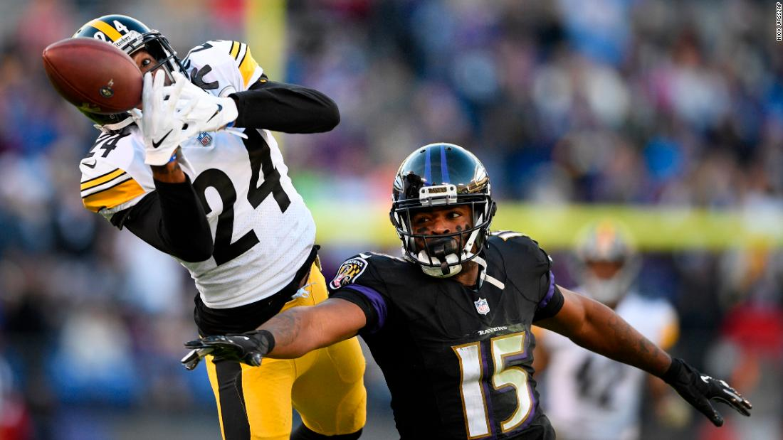 Pittsburgh Steelers cornerback Coty Sensabaugh breaks up a pass to Baltimore Ravens wide receiver Michael Crabtree in the second half of an NFL football game on Sunday, November 4 in Baltimore.