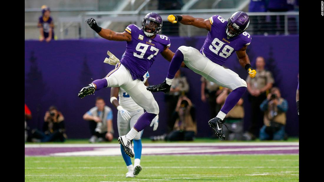 Minnesota Vikings defensive end Danielle Hunter celebrates with teammate Everson Griffen after sacking Detroit Lions quarterback Matthew Stafford during the first half of an NFL football game, Sunday, November 4, in Minneapolis.