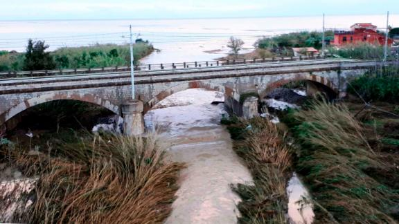 The swollen Milicia river runs in the area where nine people lost their lives when their home was flooded in Casteldaccia, near Palermo, Italy on Sunday, November 4.