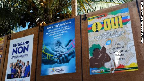 Boards with campaign posters by different political groups favoring or opposing New Caledonia's independence from France are seen during the referendum in Noumea, on the French overseas territory of New Caledonia.