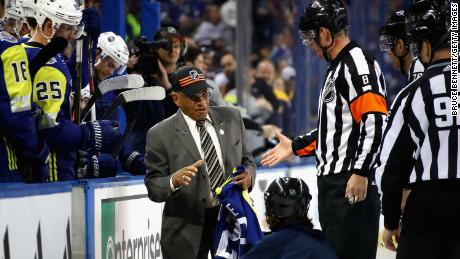 Willie O'Ree is honored on the ice during half-time of the 2018 NHL All-Star Game between the Atlantic Division and the Metropolitan Divison at Amalie Arena in January 2018.