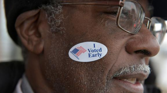 Garry Henning leaves a polling station after voting in Milwaukee on November 4.