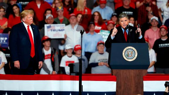 Fox News host Sean Hannity appeared on stage with President Donald Trump in Missouri just hours after having said he wouldn't do so.