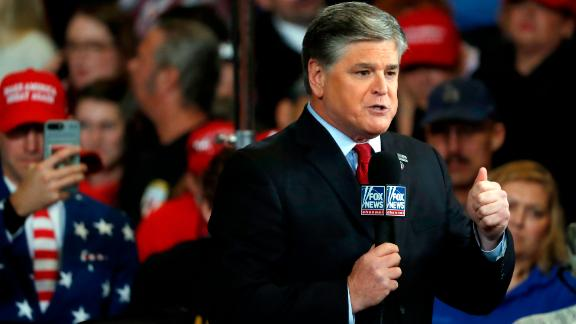 Television personality Sean Hannity does his show from the floor of a campaign rally Monday, November 5, in Cape Girardeau, Mo.