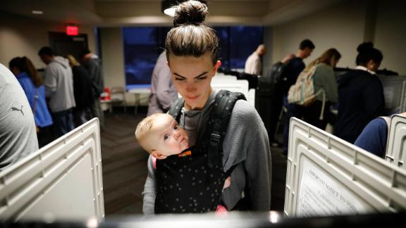 Kristen Leach votes with her 6-month-old daughter, Nora, in Atlanta.