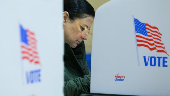 A voter casts her ballot in Glen Allen, Virginia.