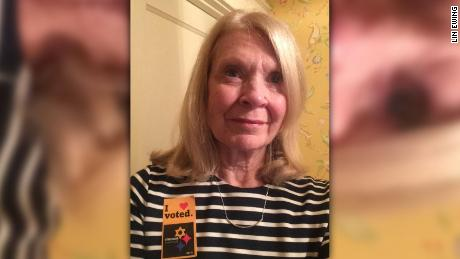"Pittsburgh resident Lin Ewing wears an ""I voted"" sticker that has become a symbol of solidarity and strength after the deadly attack at Tree of Life synagogue."