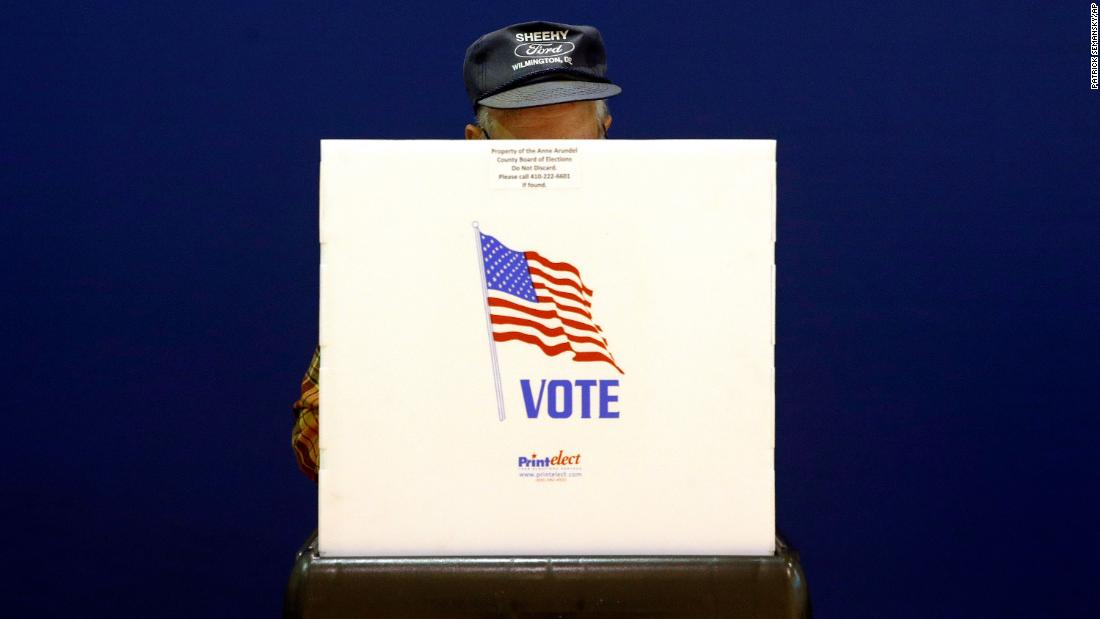 A voter fills out a ballot in Pasadena, Maryland.