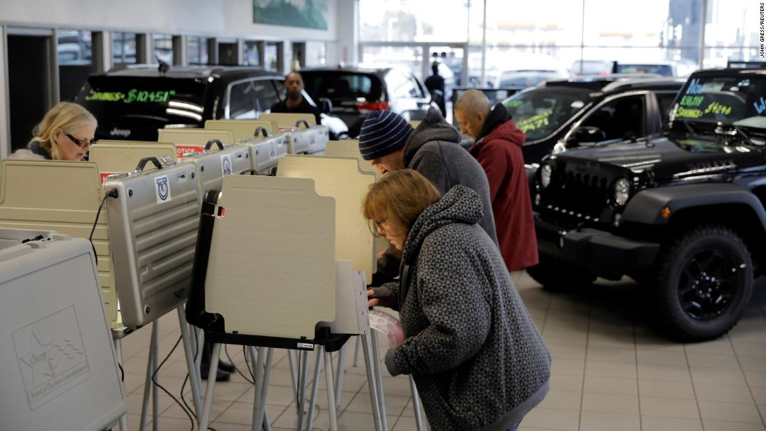 Voters cast their ballots at a car dealership in Chicago.
