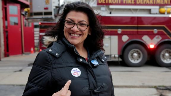 Democratic U.S. congressional candidate Rashida Tlaib points to her 'I voted' sticker after voting during the midterm election in Detroit, Michigan, U.S. November 6, 2018. REUTERS/Rebecca Cook