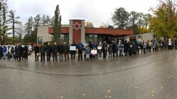 """A """"Ring of Peace"""" outside the Temple Har Zion synagogue in Toronto."""
