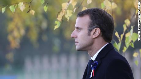French President Emmanuel Macron pays his respects to a soldier killed during World War I in Les Eparges, eastern France, on Tuesday.