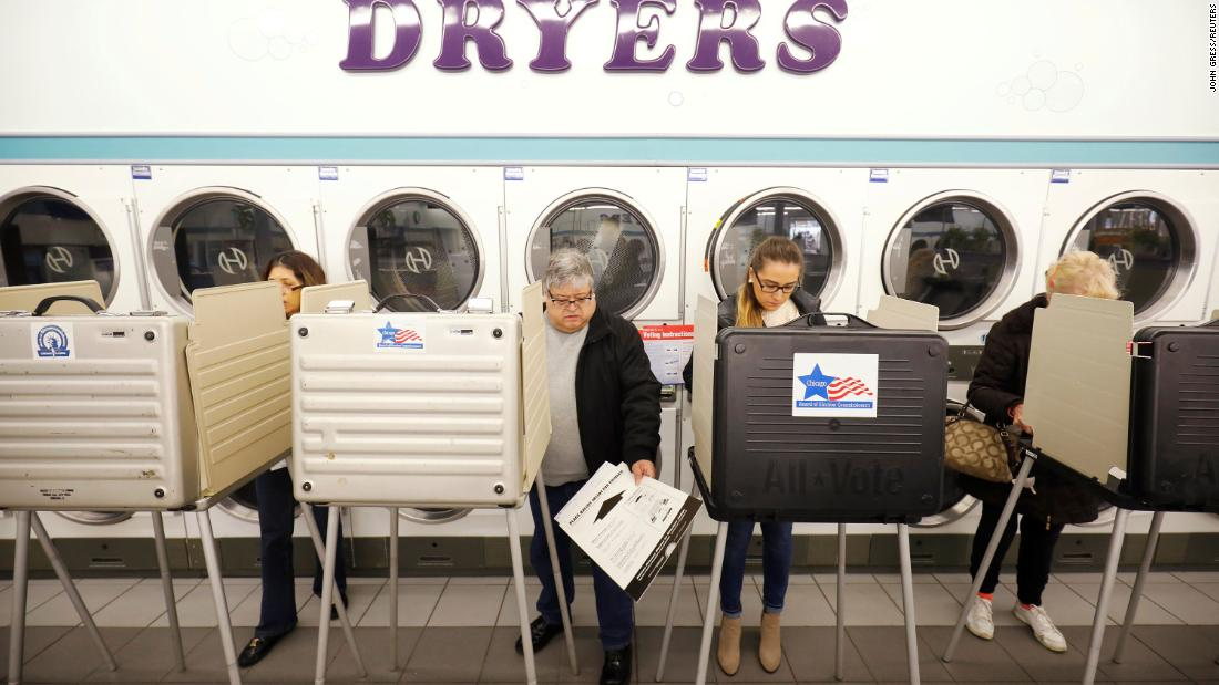 People vote at the Sunueva Laundromat in Chicago.