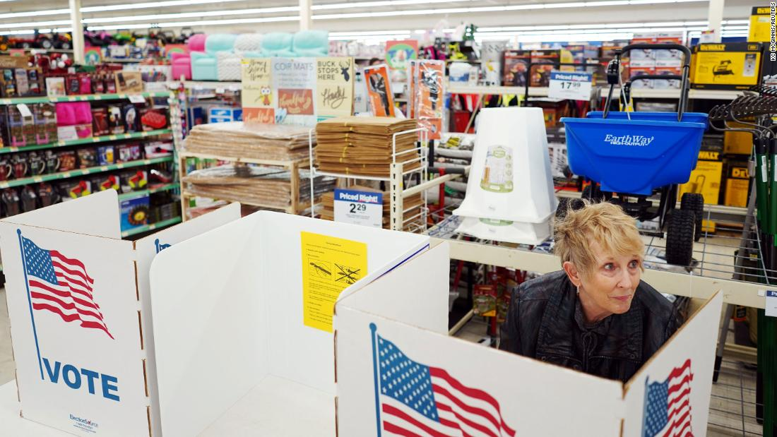 Lynda Klosterman casts her vote at a Theisen's Home & Auto store in Dubuque, Iowa.
