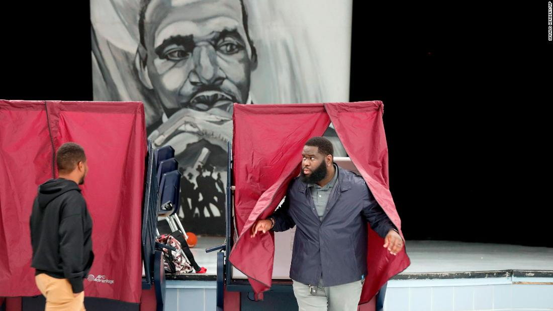 Anthony Craft exits a voting booth after casting his ballot at Martin Luther King Jr. Elementary School in New Orleans.