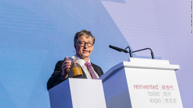Bill Gates shocks the audience with a jar of human excrement.