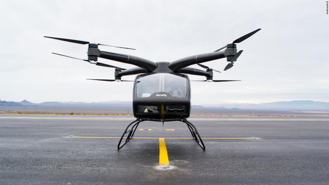 "The SureFly by Workhorse uses a hybrid electric engine to power the two-seater quadcopter. Its makers say it has a 70 mile range at 70 mph. Manned demo flights took place in <a href=""https://www.youtube.com/watch?v=7-eDuQBcAuA"" target=""_blank"">December 2018</a>."