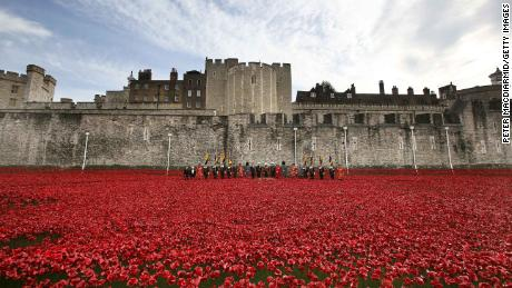 An art installation of ceramic poppies surrounds the Tower of London to mark the centenary of the start of World War I in 2014.