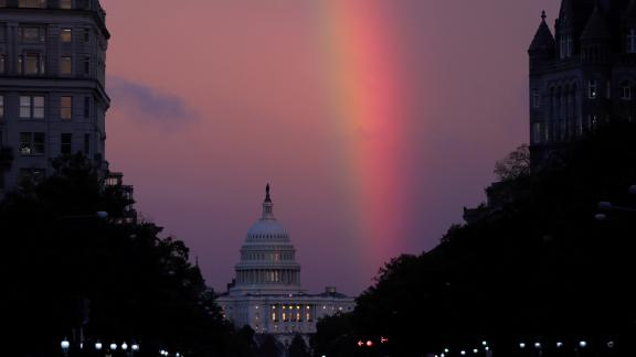 A rainbow forms over the US Capitol as evening sets in on Election Day.