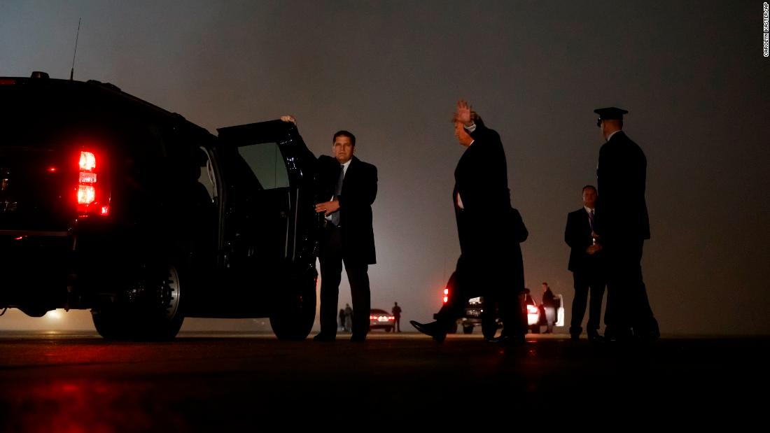 After attending campaign rallies in Indiana, Missouri and Ohio, President Donald Trump waves after arriving back in Washington on Tuesday evening.