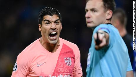 Luis Suarez shouts at an assistant referee at the San Siro stadium in Milan.