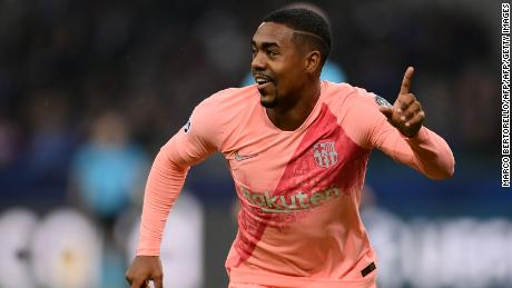 Barcelona's Brazilian midfielder Malcom celebrates after opening the scoring against Inter Milan.