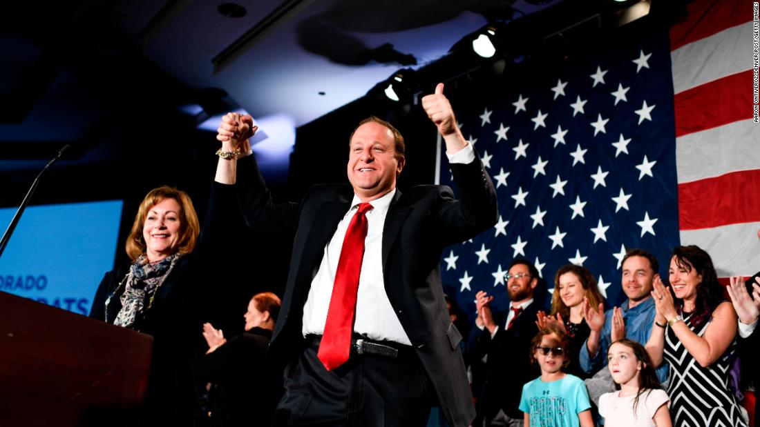"US Rep. Jared Polis celebrates on stage with running mate Dianne Primavera after it had been projected that he would become <a href=""https://www.cnn.com/2018/11/06/politics/jared-polis-colorado-gay-governor/index.html"" target=""_blank"">the next governor of Colorado.</a> Polis, a Democrat, is the first openly gay man to be elected governor of a US state."