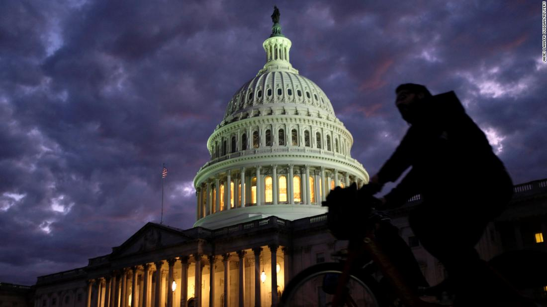 Cyclists ride past the US Capitol on Election Day.