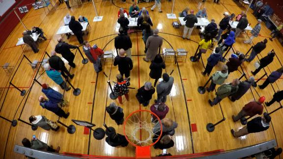 Voters wait in line at a high-school gymnasium in Brunswick, Maine.