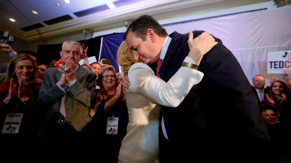 US Sen. Ted Cruz is embraced by his wife, Heidi, at his election-night party in Houston. The Republican defeated his Democratic challenger, Beto O'Rourke, CNN projects.