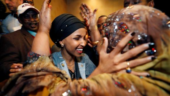 Democratic congressional candidate Ilhan Omar is greeted by her mother-in-law at an election-night party in Minneapolis. Omar and Michigan's Rashida Tlaib are the first Muslim women to be elected to Congress.