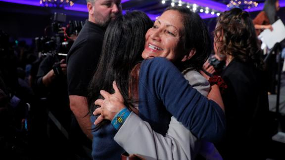 Congressional candidate Deb Haaland hugs a supporter in Albuquerque, New Mexico, after winning her race. Haaland and Kansas' Sharice Davids are the first Native American women to be elected to Congress.