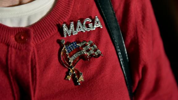 "A Donald Trump supporter wears a ""Make America Great Again"" pin at Gov. Scott Walker's election-night party in Pewaukee, Wisconsin."