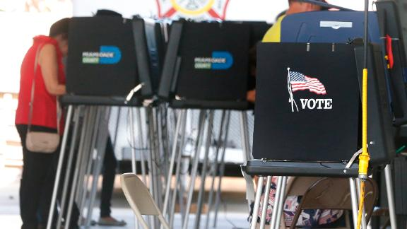 South Florida voters cast their ballots at a polling center in Miami, Florida on November 6, 2018. - Americans started voting Tuesday in critical midterm elections that mark the first major voter test of US President Donald Trump