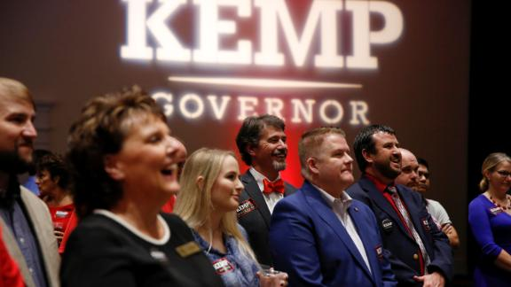 Supporters of Georgia gubernatorial candidate Brian Kemp listen to a speaker as they wait for poll numbers to come in at his election-night party in Athens, Georgia.
