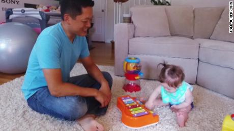 Kevin Yu, 38, plays with his daughter three years after being diagnosed with IBS.