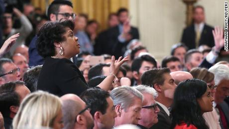 April Ryan asks questions during an exchange with Trump.