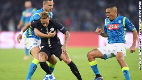 Nikola Maksimovic vies with Neymar during the Champions League match between Napoli and PSG.