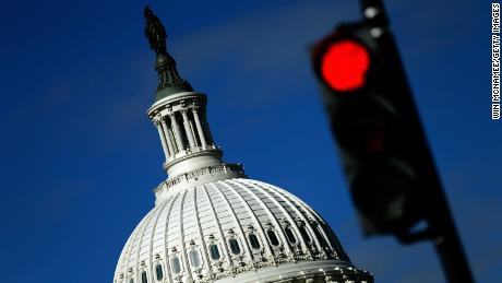 WASHINGTON, DC - SEPTEMBER 29:  A traffic light is seen in front of the United States Capitol building as Congress remains gridlocked over legislation to continue funding the federal government September 29, 2013 in Washington, DC. The House of Representatives passed a continuing resolution with language to defund U.S. President Barack Obama's national health care plan yesterday, but Senate Majority Leader Harry Reid has indicated the U.S. Senate will not consider the legislation as passed by the House.  (Photo by Win McNamee/Getty Images)