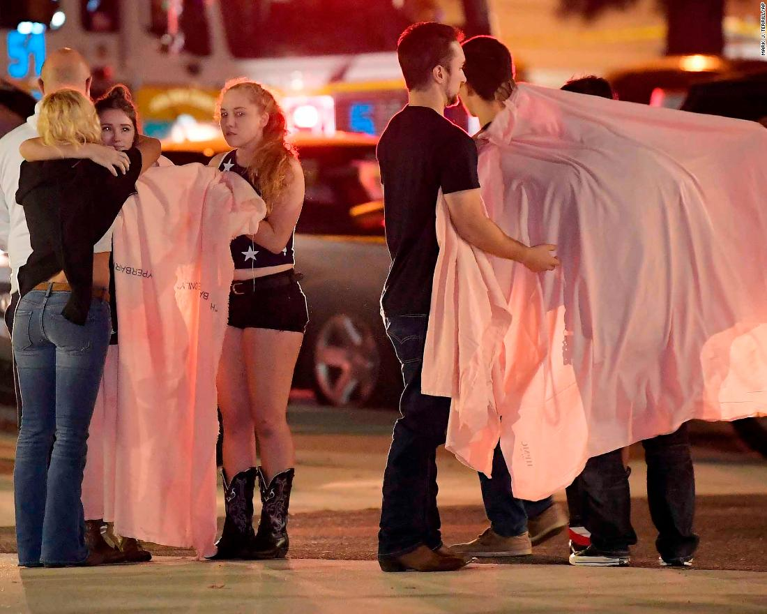 People comfort each other near the scene of a mass shooting at the Borderline Bar & Grill in Thousand Oaks, Californina, early Thursday, November 8.