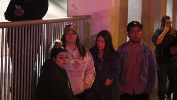 People await news about their friends in the Borderline Bar & Grill shooting.
