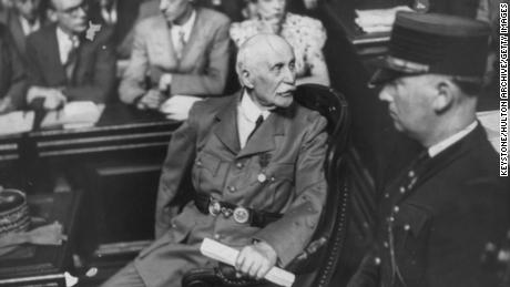 Marshal Philippe Pétain (left) is pictured in a courtroom during his 1945 treason trial.