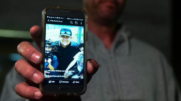 Jason Coffman displays a photo of his son Cody outside the Thousands Oaks Teene Center where he came hoping to find his son who was at the Borderline Bar and Grill in Thousand Oaks, California, on November 8, 2018. - Twelve people, including a police sergeant, were shot dead in a shooting at the bar close to Los Angeles, police said Thursday. All the victims were killed inside the bar in the suburb of Thousand Oaks late on November 7, including the officer who had been called to the scene, Sheriff Geoff Dean told reporters. The gunman was also dead at the scene, Dean added. (Photo by Frederic J. BROWN / AFP)        (Photo credit should read FREDERIC J. BROWN/AFP/Getty Images)